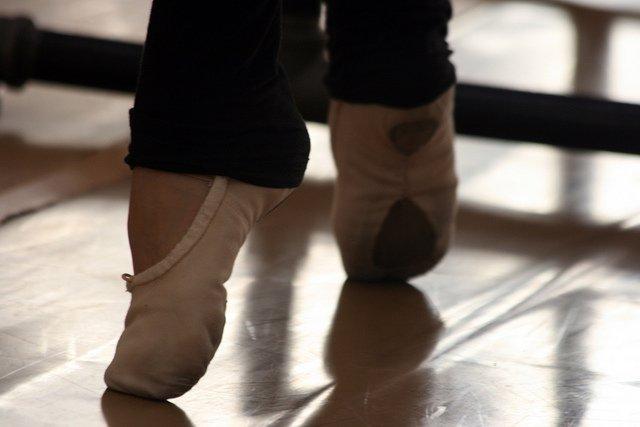 pink-ballet-slippers-black-warmers-releve