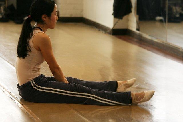 adult dancer in sweatpants in the studio