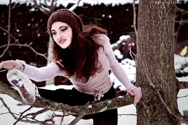 ballet dancer using a snowy tree for a barre