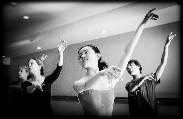 graceful adult ballet dancers in class