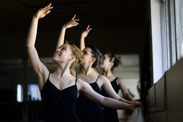 smiling dancers at barre