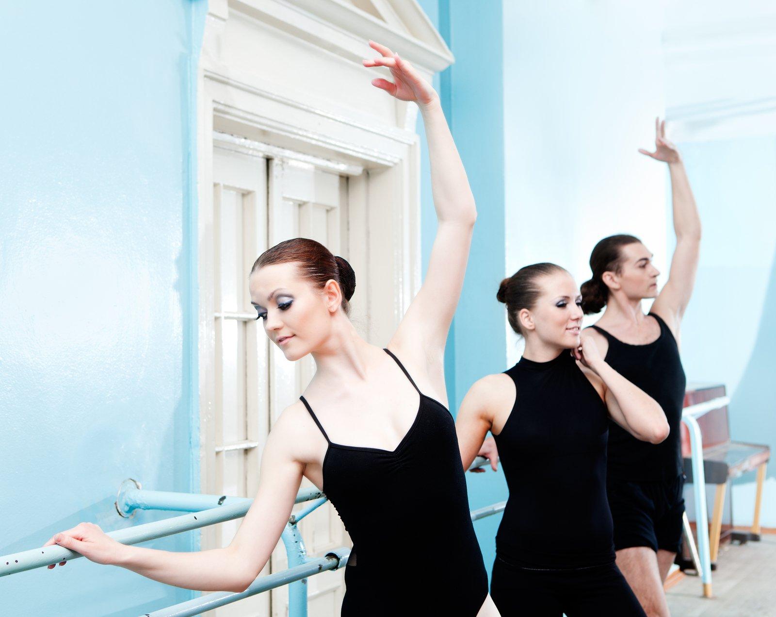 adult ballet dancers in studio rehearsal
