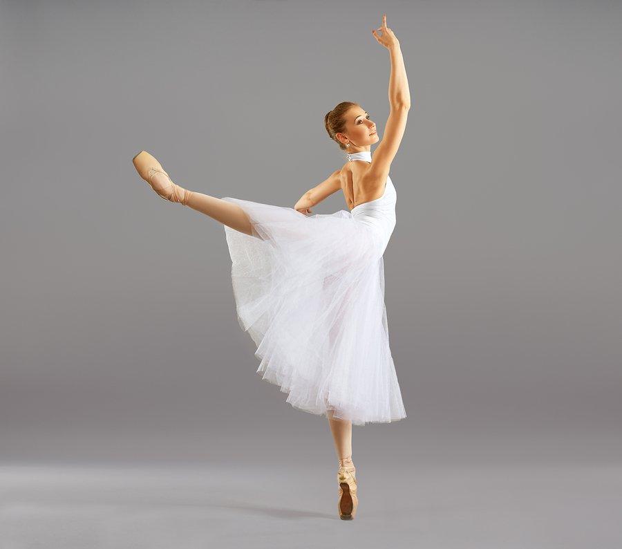 dancer in white long tutu in attitude