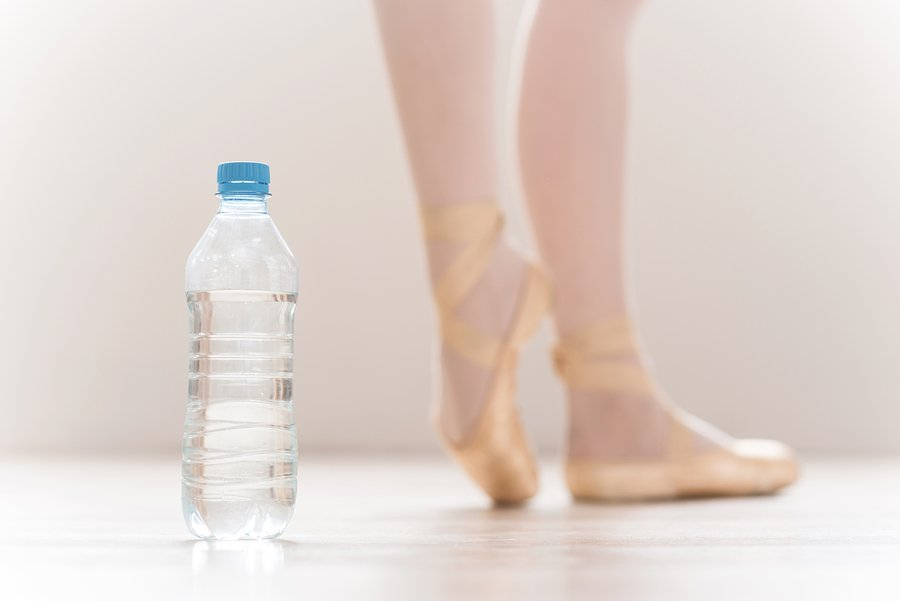 ballet dancer feet with bottle of water