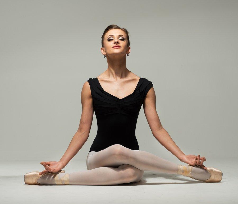 adult ballet dancer in meditative pose