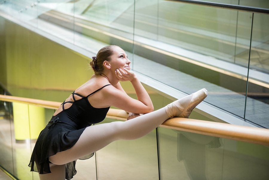 ballet dancer using escalator as a barre
