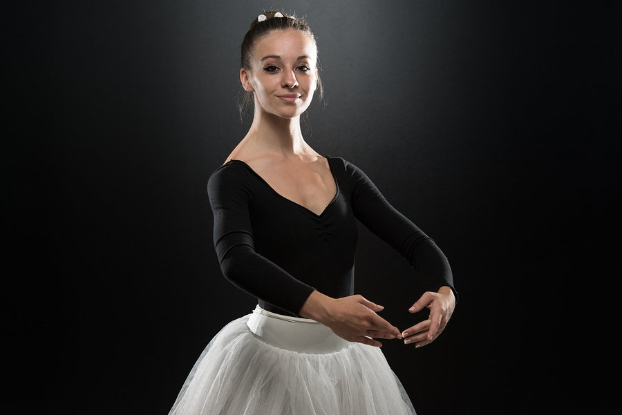 adult ballet dancer with arms in first position