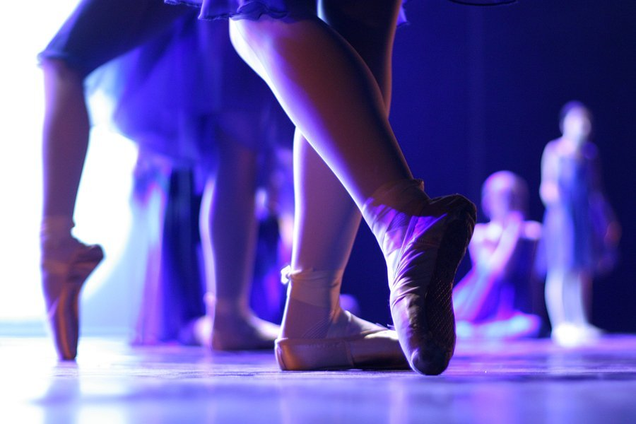 ballet dancer feet in blue light onstage