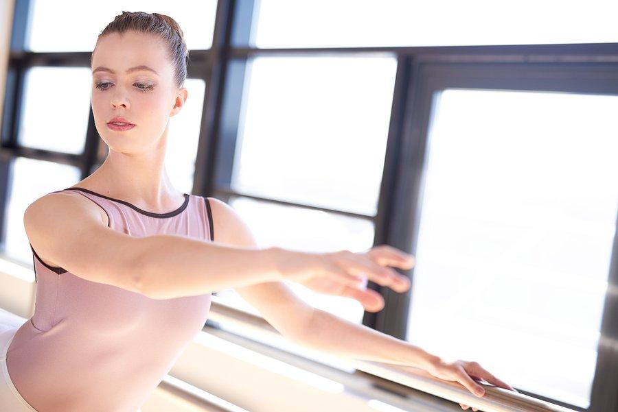 ballet dancer in pink at barre