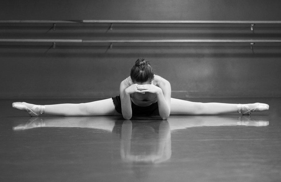stressed ballet dancer with head in hands