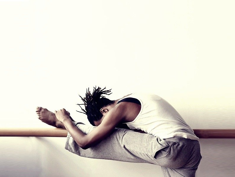 man stretching on adult ballet barrre